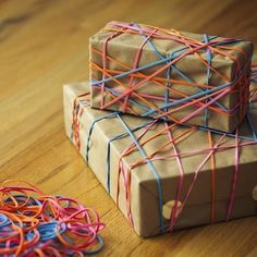 Stretch colorful rubber bands over plain kraft or butcher paper for a unique and fun-to-open present.