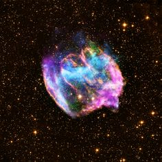 This highly distorted supernova remnant may contain the most recent black hole formed in the Milky Way galaxy. The composite image combines X-rays from Chandra (blue and green), radio data from the Very Large Array (pink), and infrared data from the Palomar Observatory (yellow). (525×525)