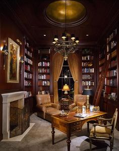 I am so in love with personal libraries. The smell, the lighting, the warmth.