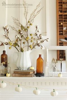 A simple cotton arrangement adds instant fall flair to a mantle.