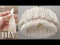 This is a tutorial on a tassel chandelier that is hardwired to be mounted in a ceiling. Tassels are made from twisted cotton twine, attached to metal rings t. Diy Tassel, Tassels, Diy Light Fixtures, Anthropologie Home, Beaded Chandelier, Chandelier Lighting, Decoration, Diy Home Decor, Diy Projects