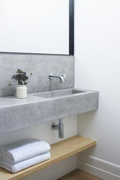 cement vanity | custom vanity | modern lines | minimal | floating shelf storage | white oak timber | hexagon tile | walk-in shower | marble | sage | white | Pipkorn & Kilpatrick Interior Architecture and design | Brighton house