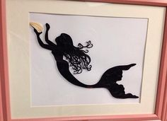 This is a Framed 11x14 Custom Framed Art Piece. Stunning mermaid silhouette using the technique of quilling. The item does come framed and frame may vary from photo. According to Wikipedia, Quilling is the art of creating decorative designs from thin strips of curled paper.  Using simple tools, long strips of paper are tightly wound and released to form complicated and complex shapes. This form of art was also known as Paper Filligree.