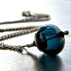 midnight blue hollow glass bead necklace by jewel