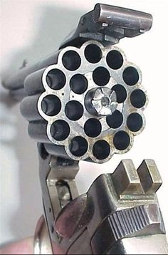 Belgium made dead-least revolver fire 3 bullets at a time from 3 tubes and loads 18 bullets at a time. Belgium made dead-least revolver fire 3 bullets at a time from 3 tubes and loads 18 bul Weapons Guns, Guns And Ammo, Rifles, Fire Powers, Cool Guns, Awesome Guns, Survival Knife, Firearms, Shotguns