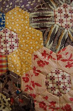 Detail.  An unfinished patchwork coverlet, the patches mainly 1860-70 but including some 1830s chintzes, the original paper templates retained on the reverse, 270 by 223cm, 106 by 88in