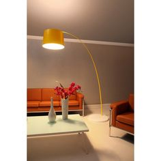 Light up your decor with this chic simple floor lamp. Available in black, white, red or yellow, this lighting fixture will complement any decor scheme.