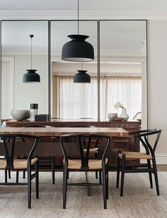 dining room with black wishbone chairs and gubi 'rode' pendant light | Figtree House by Arent&Pyke