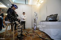A attendee wears a Sony Corp. PlayStation VR headset and a Synesthesia Suit produced by Enhance Games Inc., Rhizomatiks Co. and Keio Media Design, while playing video games at the Japan VR Summit 2 in Tokyo, Japan, on Wednesday, Nov. 16, 2016. The annual two-day event runs through Nov. 17. Photographer: Akio Kon/Bloomberg via Getty Images