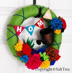 Spring / summer wreath I made.  Yarn wrapped with hand made felt flowers. http://salttree.blogspot.com/2011/06/summer-time-wreath.html