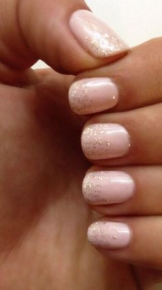 Soft pink nails with ombré golden glitter.