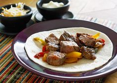 Grilled Steak Fajitas - Have a backyard fiesta and make it a fajita party! These steak fajitas are easy enough to make as a weeknight meal, or fun to create a theme party and serve up all your favorite Mexican appetizers. #recipe #weightwatchers 8 points+ #sandwich