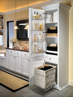 Design idea: Customized bathroom cabinet.  Why: Storing towels in the bathroom is convenient, and incorporating a spot for dirty laundry and bath essentials makes the space work even harder.  How: Outfit an existing cabinet with a pullout laundry bin, wire door storage and adjustable shelves. If you are planning a bathroom remodel, work with a bath designer to incorporate the features you want.
