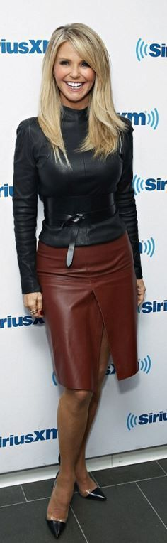 Break the rules and pair brown with black. Brown knee-length faux leather skirt with front slit paired with black faux leather long-sleeved top.. DIY the look yourself: http://mjtrends.com/pins.php?name=faux-leather-fabric-for-clothing
