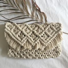 Hand-made macrame bag with fringing and strap made by Han from HANmademacrame.  It can also be used as a clutch bag by tucking the strap inside the bag.    Made with 100% cotton in natural colour.     Measurements:  - Width 26cm  - Height 17cm  - Length of strap 98cm    Also available in other patterns.