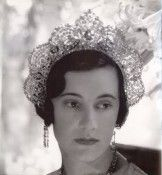 DUCHESS LOELIA OF WESTMINSTER. The third wife of the unpleasant 2nd Duke of Westminster, who dallied with Coco Chanel. Loelia suffered her marriage to His Grace for seventeen years. The Duke showered Loelia with jewels and dressed her up as seen here, wearing the famous Lacloche Tiara set with the Arcot Diamonds that were later bought by Harry Winston