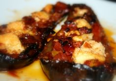 """Papoutsakia (""""little shoes"""") ... yummy stuffed eggplant with a lovely bechamel sauce."""