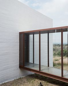 Glass-and-steel corridors link a home in Mexico