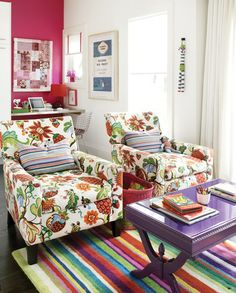 Bright chairs, rug, accent wall