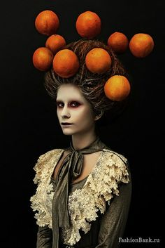 But what he thought was a painting stirred. And as the globes turned first to orange and then a blood red, two eyes slowly rose to meet his own.(girl and oranges by Anna Kubanova https://www.behance.net/gallery/Girl-And-Oranges/2909173)