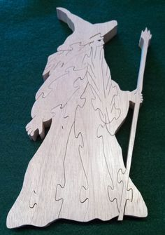 The wise Wizard blazes the trail with his magical staff, leading questers on great adventure! Standing 9.5 tall, this 3/4 mahogany Wizard puzzle