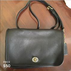 COACH black purse COACH Leather black purse with strap. Has inside and outside pocket. Coach Bags Crossbody Bags