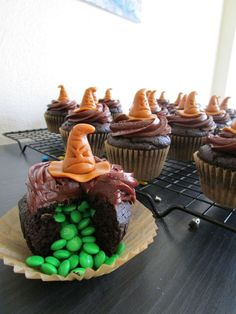 Check out the Harry Potter Sorting Hat cupcakes I made! You get sorted into a Hogwarts house depending on the color of the M&Ms that spill out. Apparently I'm a Slytherin...