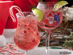 These pomegranate-infused Santa Spritzers have a splash of rum!