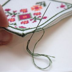 """This cross stitch tutorial will show you how to make a simple and beautiful keepsake cross stitch needle book or needle case. The finished dimensions of this needle case are 3"""" x 4"""" when using 14-c..."""