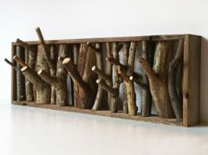 DIY coat and hat hooks made of thick cut forked branches