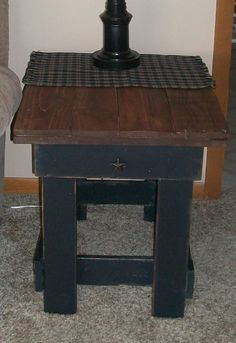 This is a prim country table that I made out of pallet wood, and some 2x4's :)