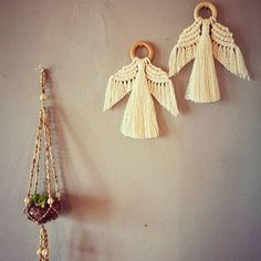 Handmade macrame Angel. Unique minimal design adds subtle style for the festive season. Works as a wall hanging or tree decoration. Each Angel is hand knotted using unbleached cotton cord and untreated wood ring. Tassel fringe is hand combed. As this is a handmade please expect some slight