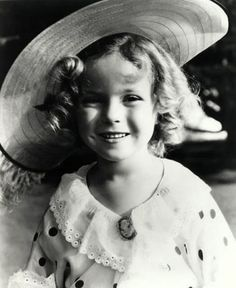 Shirley Temple ~ an extremely talented little girl who thrilled the world with her acting, singing & dancing. She was the cutest little thing on the screen in her days at Hollywood, with her bouncing curls, cheeky dimpled face, and melt-your-heart-smile. She danced, sang, & tapped her way into people's hearts. Beautiful child-star.