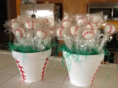 Baseball pots filled with Cake pops. Handpainted Pot to look like a basball.