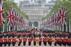 Britain's Queen Elizabeth II rides in a carriage along the Mall during the Trooping The Colour parad... - The Associated Press