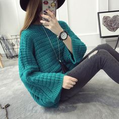 Loose sweater Pullover Sweater Fall / winter clothing Women's sweater Solid color round neck trumpet Sleeve 80% Woolen sweater