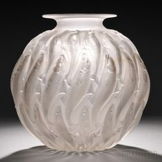 Rene Lalique Marisa Vase | Mold-blown glass  Marcilhac 1002, France, design introduced 1927  Spherical form in clear and satin finishes decorated w/ fish in relief, base acid- etched R. Lalique and engraved France