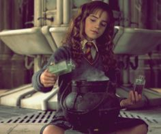 hermione brewing a polyjuice potion in moaning myrtle's bathroom. chamber of secrets.