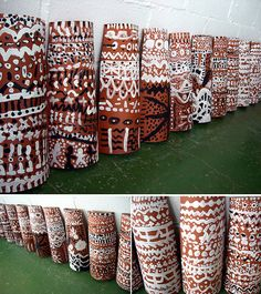 Use terra cotta pipe halves or terra cotta roof tiles that are ready to paint on.  These have been painted.  Another I idea that students have enjoyed is to draw with oil pastels and then paint.   Have fun and be prepared to create a spectacular display.