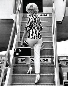 Not quite the right era for China's Wings, but here it is anyway: Marilyn boarding Pan Am.