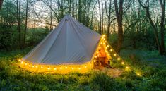 South coast galloping : Bell tent with festoon lighting by dusk