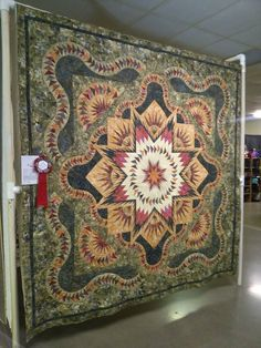 Glacier Star designed by Quiltworx.com, made by Dr. Susan Crawford, and quilted by Marlene Oddie of KISSed Quilts.