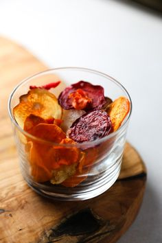 Carrots, parsnips, celery root, sweet potatoes, taro, and beets are starting to edge their way into the cold bin. Roasted with herbs, browned in butter with a little brown sugar… slicing into them smells like fall—and like Thanksgiving, really. And I've discovered that baking them into chips is one of the simplest (and prettiest) ways …