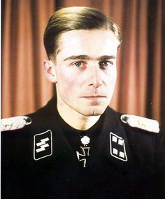 The highly decorated SS-Standartenführer Joachim Peiper, 1.SS Division Leibstandarte SS Adolf Hitler. Peiper was convicted of war crimes and is mainly remembered as being complicit in the Malmedy massacre when on December 17th, 125 Americans were captured and gunned down by Peiper's men and was also accused of being complicit in the murder of another nineteen unarmed and captured Americans at Honsfeld and another 50 Americans at Büllingen.