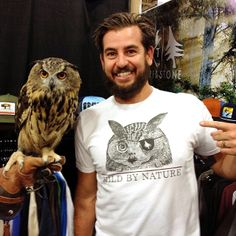 A guy with an owl just happened to walk by our tradeshow booth. Perfect photo op for our new Wild Tee. Comes in white and heather blue. Available now at specialty surf and outdoor shops and hippytree.com. #surfandstone #tuesdaystee