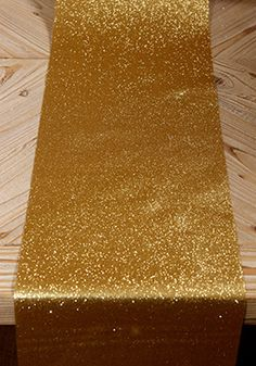 """9.99 SALE PRICE! Decorate your tables with an abundance of glamour using this gold glitter ribbon! This 10"""" wide ribbon is covered with glitter on one side o..."""