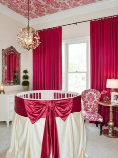 An elegant baby's nursery with red colour theme. What a timeless and stylish baby's room #Baby #Nursery