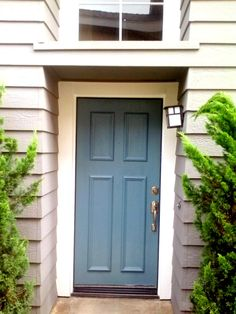 Blue front door beach house painting
