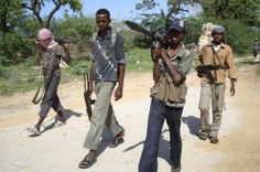 Hardline Islamist militants from Hezb al-Islamiya patrol a deserted road in southern Mogadishu May 25, 2009.