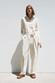 An ivory jumpsuit like this could look elegant but I would pair it with more sophisticated accessories and heels